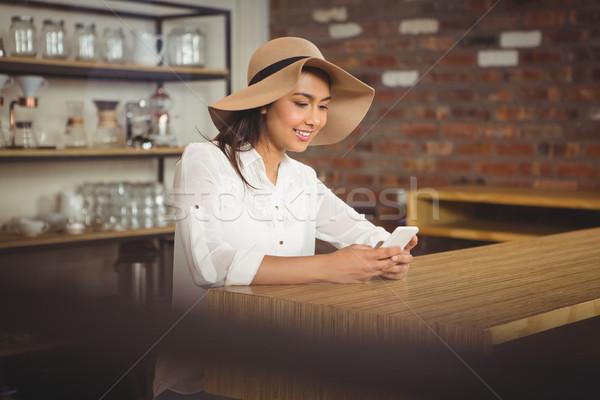 Casual businesswoman using her phones  Stock photo © wavebreak_media