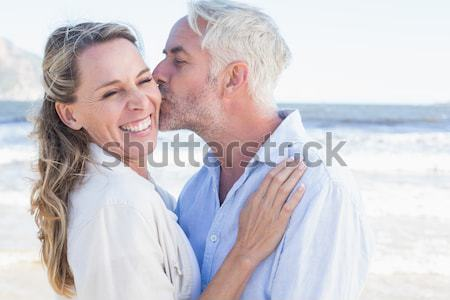 Couple looking to left against blurry beach Stock photo © wavebreak_media
