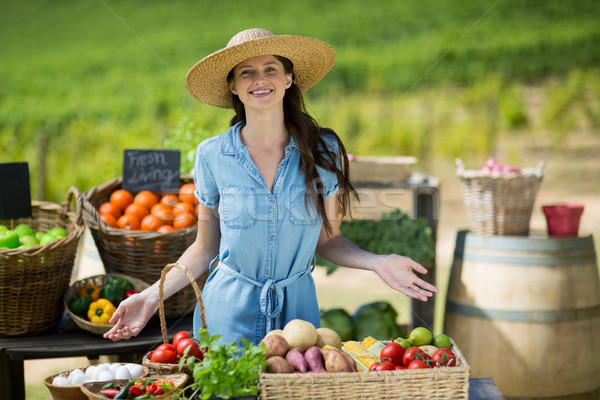 Stock photo: Portrait of smiling woman selling vegetables