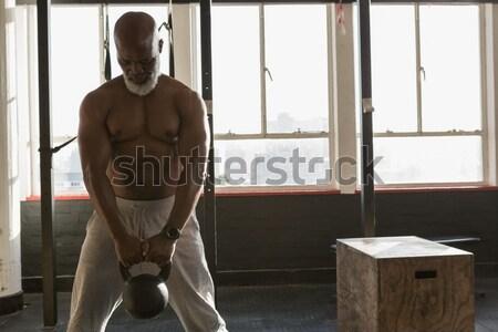 Stok fotoğraf: Gülen · işadamı · oturma · tablo · modern · ofis