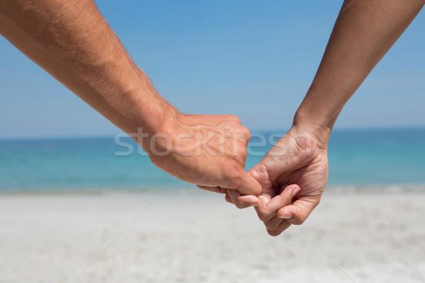 Cropped hands of couple holding little fingers Stock photo © wavebreak_media