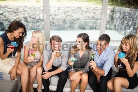 Amigos champán balcón casa mujer feliz Foto stock © wavebreak_media