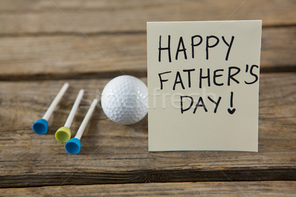 Close up of fathers day message with golf ball and tee  Stock photo © wavebreak_media