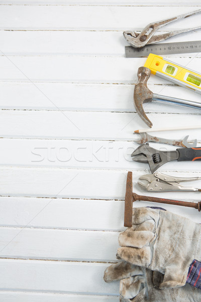 Hand tools arranged on white wooden table Stock photo © wavebreak_media