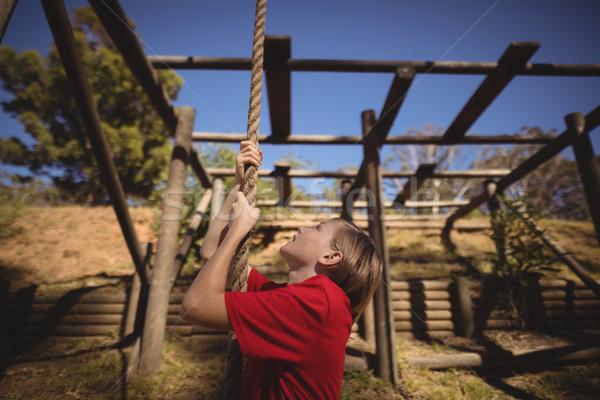 Bestimmt Mädchen Klettern Seil Hindernisstrecke Boot Stock foto © wavebreak_media