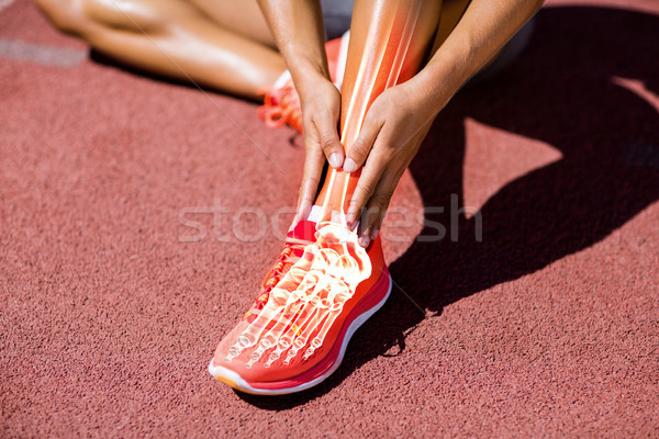 Low section of athlete suffering from pain on track Stock photo © wavebreak_media