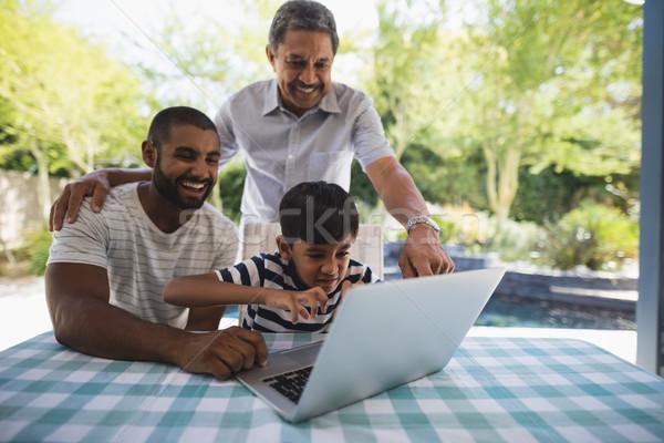 Wesoły rodziny za pomocą laptopa weranda wraz tabeli Zdjęcia stock © wavebreak_media