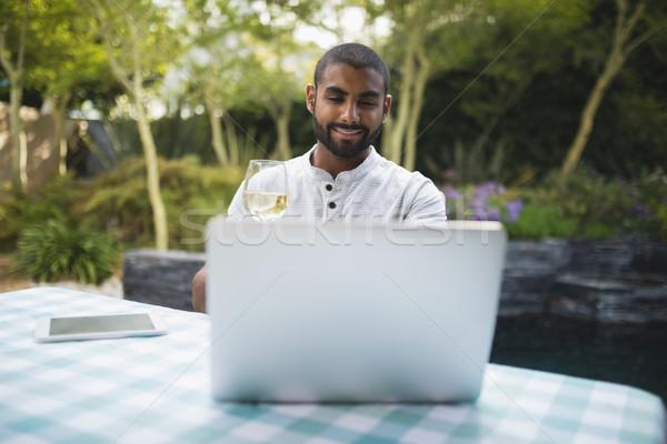 Man holding wineglass while sitting at porch Stock photo © wavebreak_media