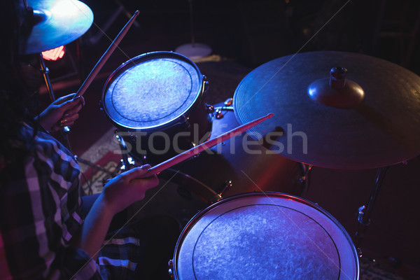 Drummer playing drum kit in nightclub Stock photo © wavebreak_media