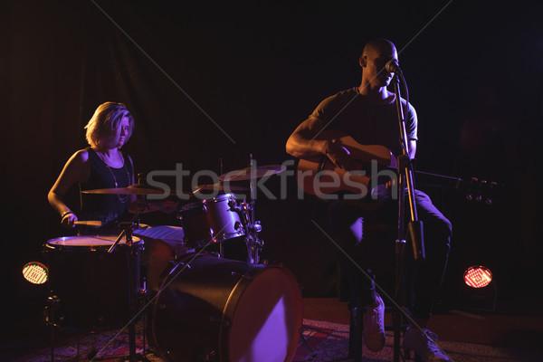 Singer with female drummer performing in nightclub Stock photo © wavebreak_media