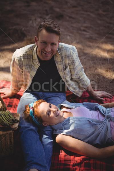Portrait of smiling couple resting on field at farm Stock photo © wavebreak_media