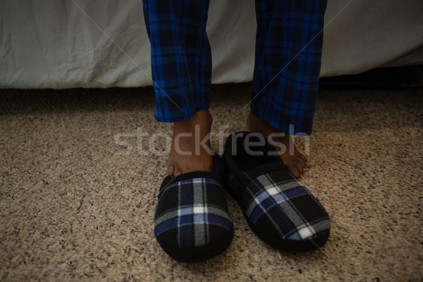 Low section of man by shoe on floor Stock photo © wavebreak_media
