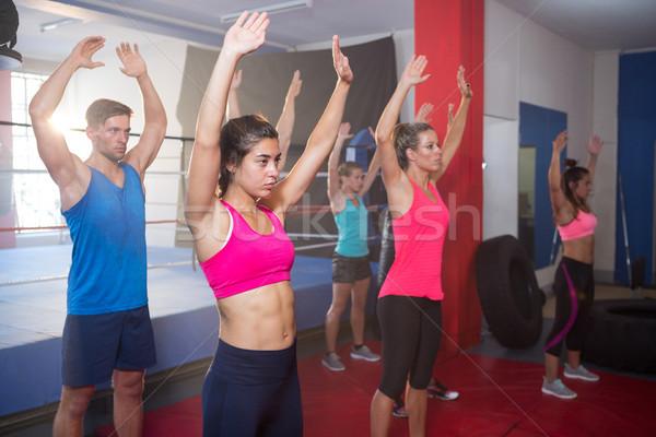 Fiatal sportolók testmozgás karok a magasban box gyűrű Stock fotó © wavebreak_media