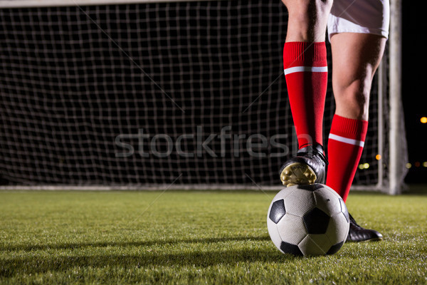 Low section of male soccer player with ball on field Stock photo © wavebreak_media