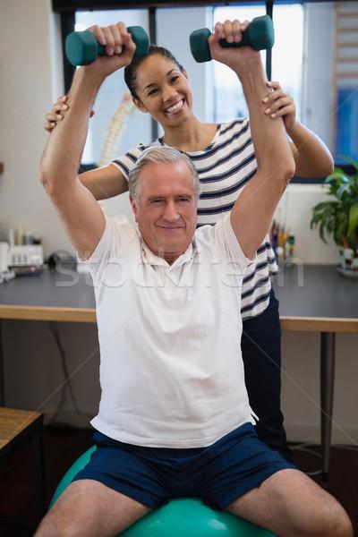 улыбаясь женщины врач глядя старший пациент Сток-фото © wavebreak_media