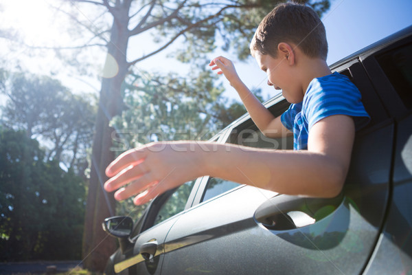 Teenage boy looking from open car window Stock photo © wavebreak_media