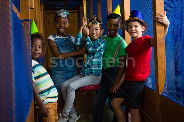 Portrait of smiling children in jungle gym Stock photo © wavebreak_media
