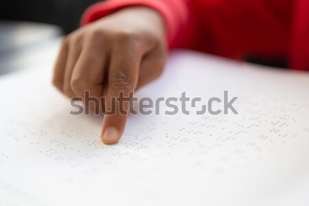 Cropped hands on man reading braille book in retirement home Stock photo © wavebreak_media