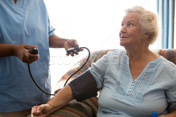 Nurse examining patient in nursing home Stock photo © wavebreak_media