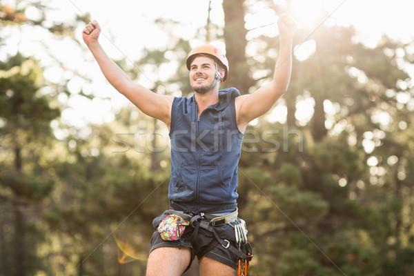 Handsome young hiker looking away and cheering Stock photo © wavebreak_media