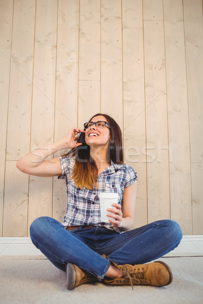 Pretty hipster on the phone holding cup Stock photo © wavebreak_media