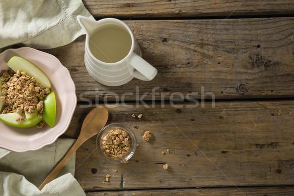 Piatto colazione cereali frutti latte tavolo in legno Foto d'archivio © wavebreak_media