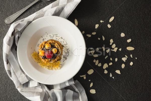Plaque déjeuner céréales fruits bol lait Photo stock © wavebreak_media