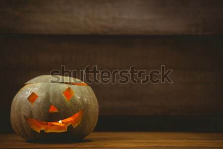 Illuminated jack o lantern on table during Halloween Stock photo © wavebreak_media