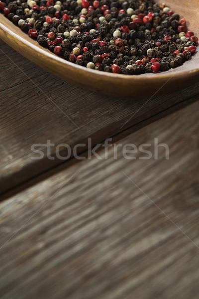 Mix peppercorns in wooden bowl Stock photo © wavebreak_media