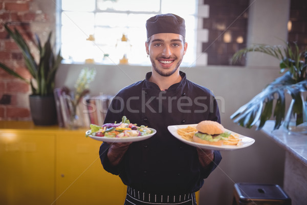 Portrait of smiling young waiter serving fresh food Stock photo © wavebreak_media