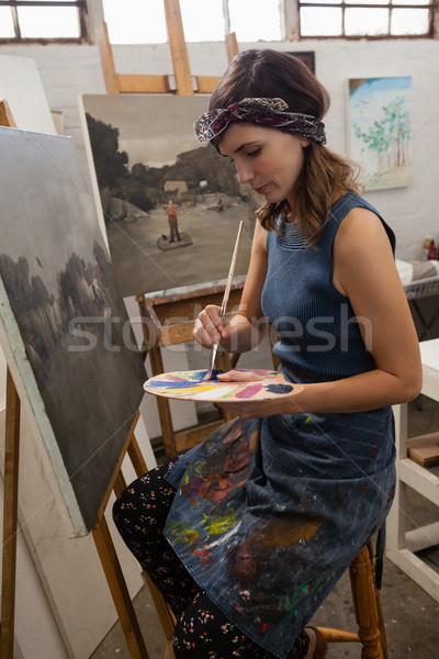 Woman painting on canvas in drawing class Stock photo © wavebreak_media