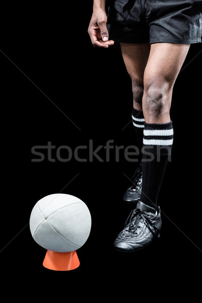 Rugby ball on kicking tee by sportsman Stock photo © wavebreak_media
