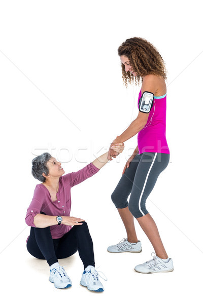 Friend assisting woman in getting up Stock photo © wavebreak_media