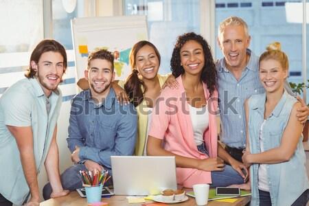 Businessman taking selfie of colleagues in meeting room Stock photo © wavebreak_media