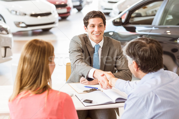 Smiling couple buying a new car Stock photo © wavebreak_media