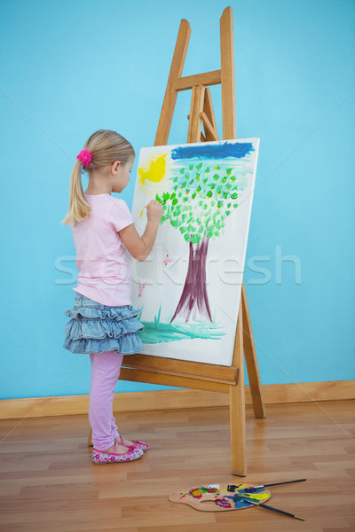 Girl painting her colourful picture Stock photo © wavebreak_media