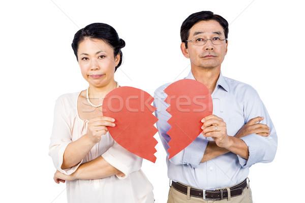 Couple holding broken heart Stock photo © wavebreak_media