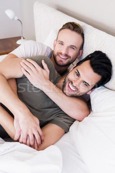 Mutlu eşcinsel çift yatak ev adam Stok fotoğraf © wavebreak_media