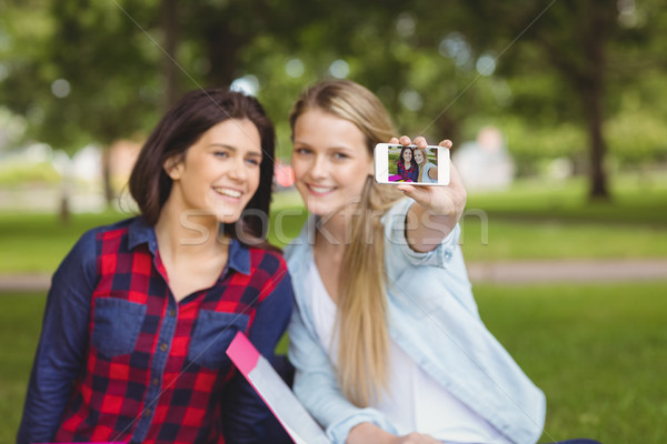 Smiling students taking a selfie outdoor  Stock photo © wavebreak_media