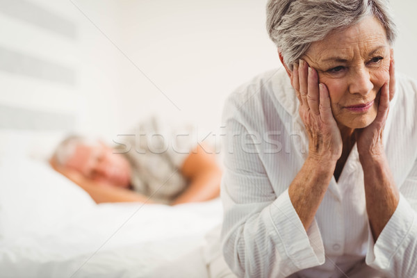 Worried senior woman sitting on bed Stock photo © wavebreak_media