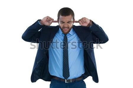 Irritato imprenditore orecchie bianco business suit Foto d'archivio © wavebreak_media