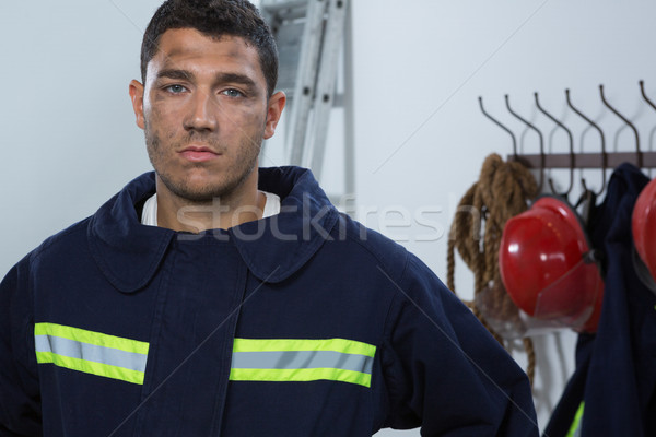 Tiered fireman standing in the office Stock photo © wavebreak_media