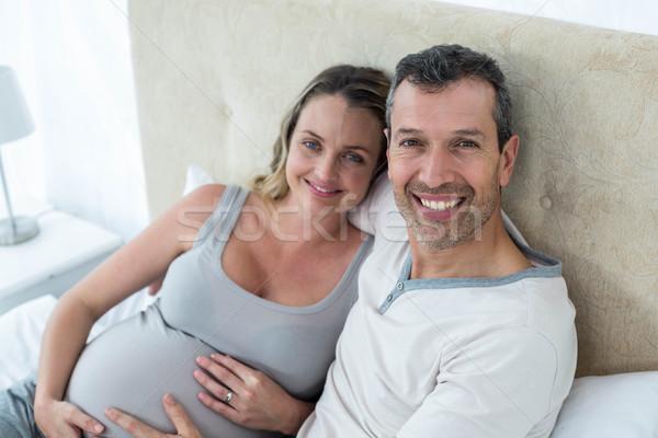 Expecting couple sitting on bed Stock photo © wavebreak_media