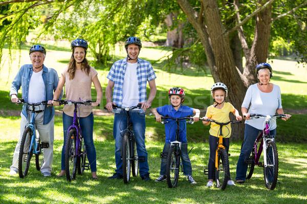 Smiling family with their bikes Stock photo © wavebreak_media