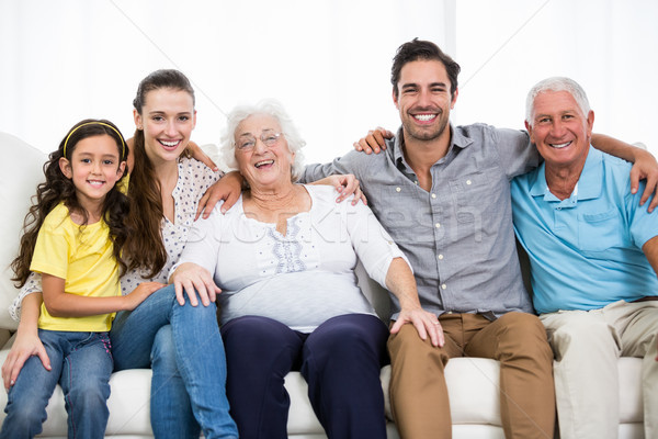 Portrait of smiling family with arm around  Stock photo © wavebreak_media