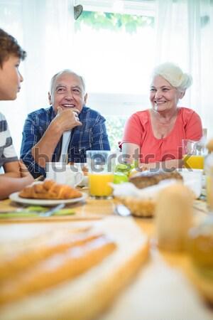 Portrait of smiling grandparents with family Stock photo © wavebreak_media