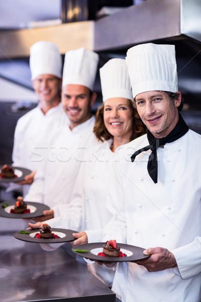 Portrait heureux chefs dessert plaques Photo stock © wavebreak_media