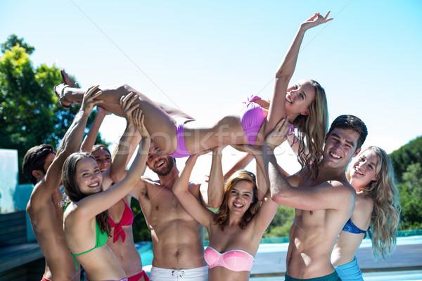группа друзей женщину бассейна Сток-фото © wavebreak_media