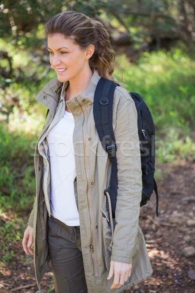 Gülümseyen kadın sırt çantası kadın mutlu doğa Stok fotoğraf © wavebreak_media