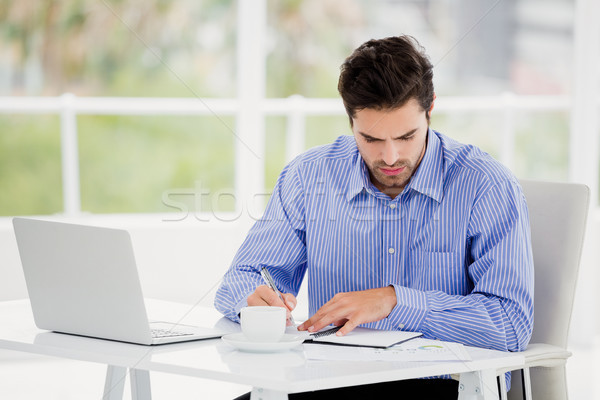 Businessman writing in diary Stock photo © wavebreak_media